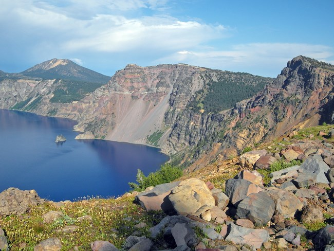 Mountain and view of Crater Lake in summer